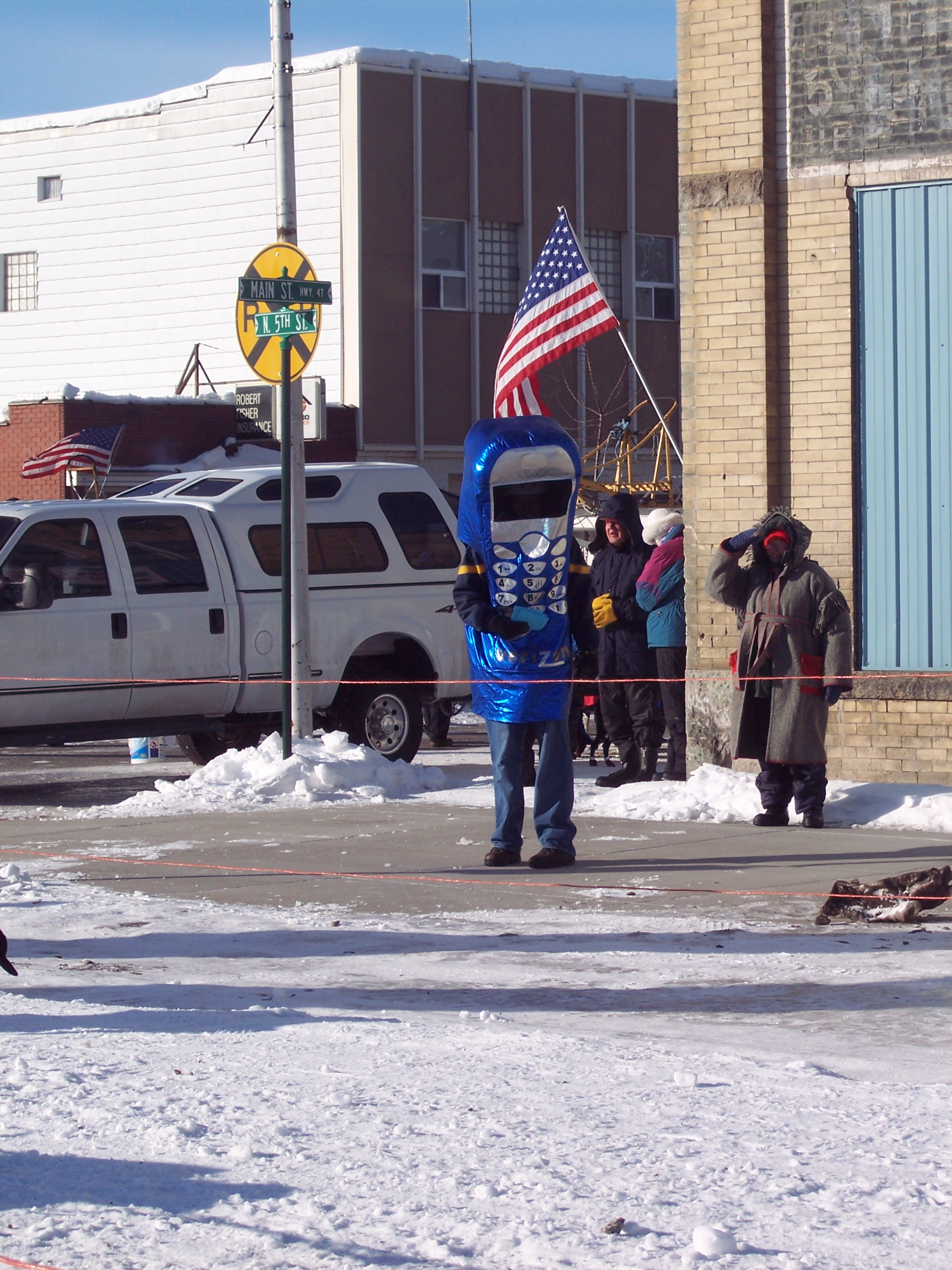 Many different kinds of spectators cheered on the dogs and mushers